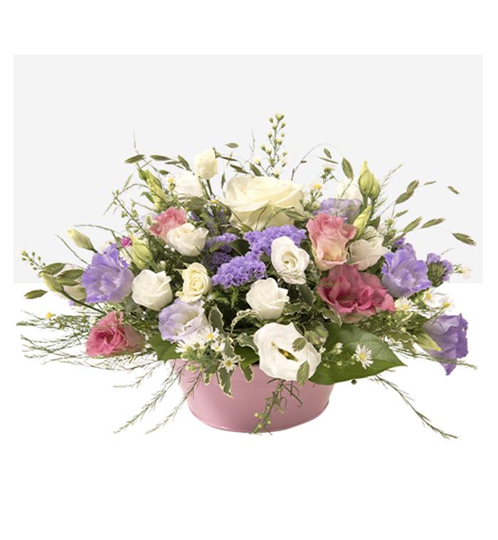 Tendresse composition piquée dans de la mousse florale humide avec son contenant assorti - 50€